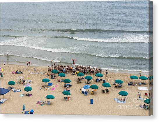 A Lifeguard Gives A Safety Briefing To Beachgoers In Ocean City Maryland Canvas Print