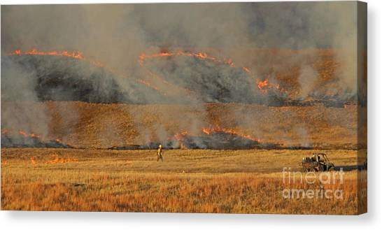 A Lone Firefighter On The Norbeck Prescribed Fire. Canvas Print