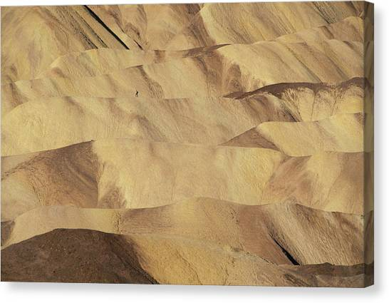 Lonliness Canvas Print - A Lone Hiker Traverses A Ridge by Eric Rorer
