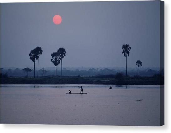 Congo River Canvas Print - A Magnificent View Of Sunset As Two by Robert Caputo