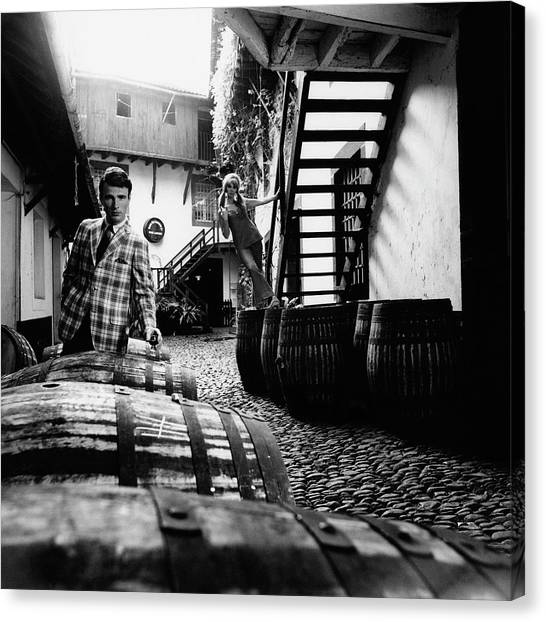 Wine Barrels Canvas Print - A Male Model Posing By Wine Barrels by Leonard Nones