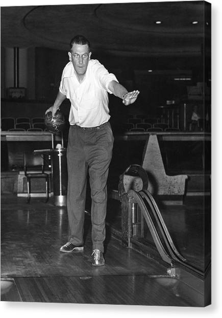 Bowling Shoes Canvas Print - A Man Bowling by Underwood Archives