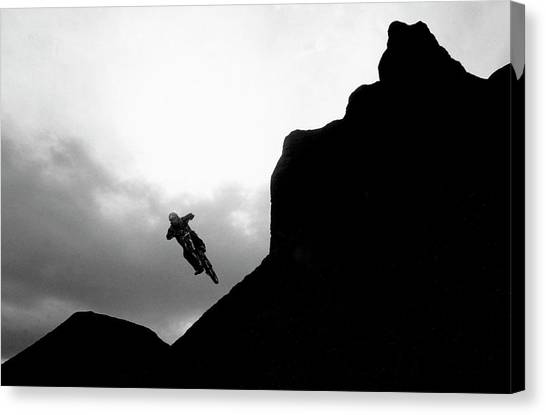 Freeriding Canvas Print - A Man Catches Air On His Mountain Bike by Scott Markewitz