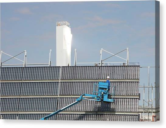 Clean Energy Canvas Print - A Man Cleans Solar Panels by Ashley Cooper