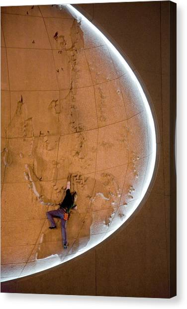 Climbing wall canvas prints page 6 of 48 fine art america climbing wall canvas print a man climbing on a world map by venture media group gumiabroncs Choice Image