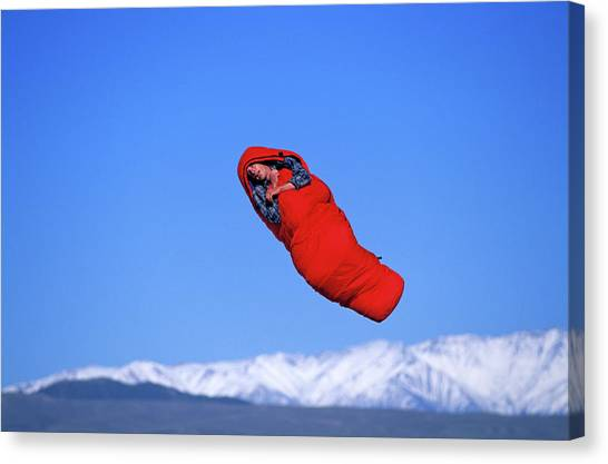Trampoline Canvas Print - A Man Floats While Napping by Corey Rich