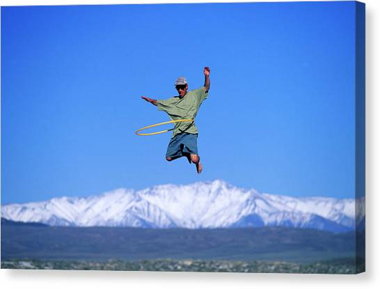Trampoline Canvas Print - A Man Hulahoops While Jumping by Corey Rich