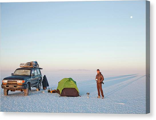 4x4 Canvas Print - A Man In A Down Jacket Stands by David Hanson