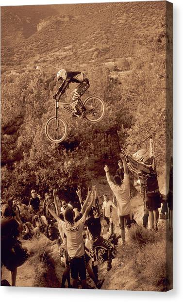 Freeriding Canvas Print - A Man Jumps His Mountain Bike In Apt by Scott Markewitz