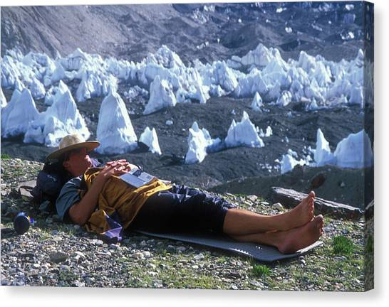 Mount Everest Canvas Print - A Man Naps On A Glacier With His Hat by Jimmy Chin
