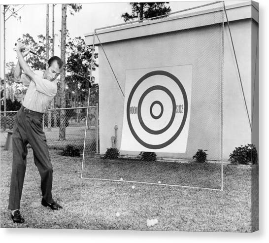 Golf equipment canvas print a man practices golf by underwood archives