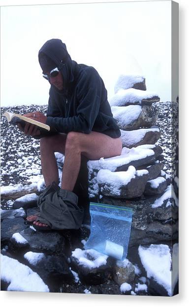 Mount Everest Canvas Print - A Man Reads While Using A Snow-covered by Jimmy Chin