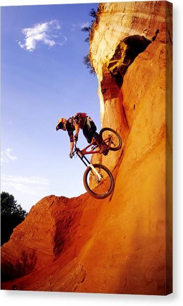 Freeriding Canvas Print - A Man Rides His Mountain Bike by Scott Markewitz