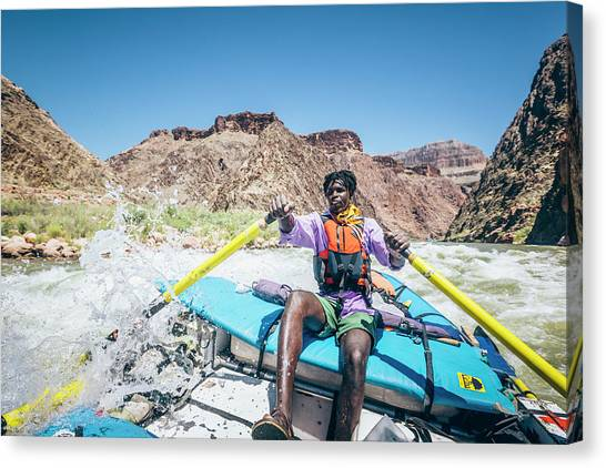 Colorado Rapids Canvas Print - A Man Rows A Raft In A Rapid by Andrew Peacock