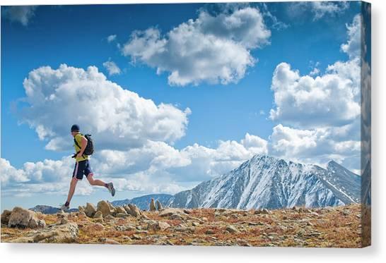 Backpacks Canvas Print - A Man Runs Along An Alpine Ridge by Randall Levensaler