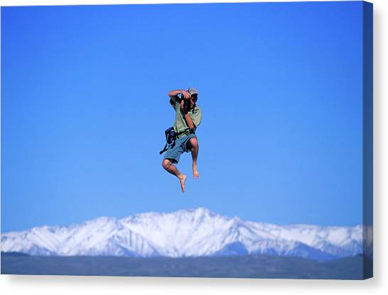 Trampoline Canvas Print - A Man Takes A Photo While Jumping by Corey Rich