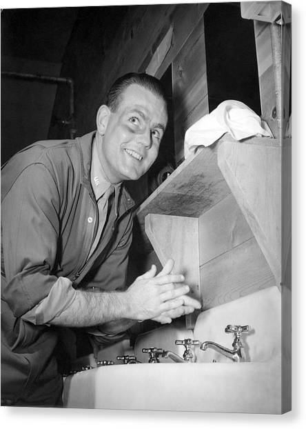 Hand Washing Canvas Print - A Man Washing His Hands by Underwood Archives