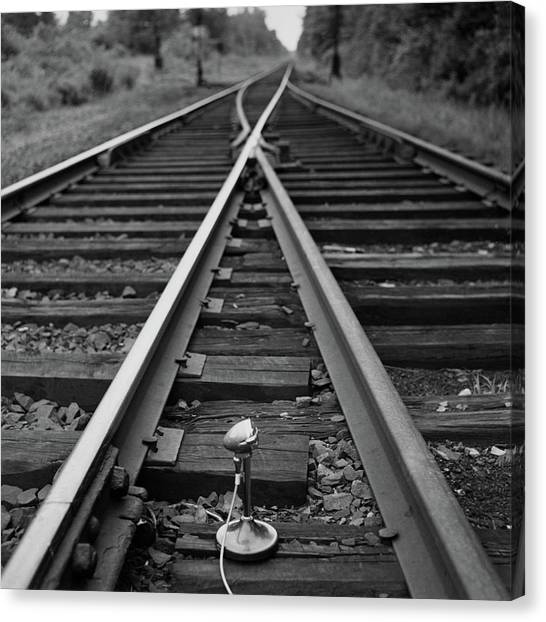 Microphones Canvas Print - A Microphone Placed In Between Railroad Tracks by Richard Rutledge