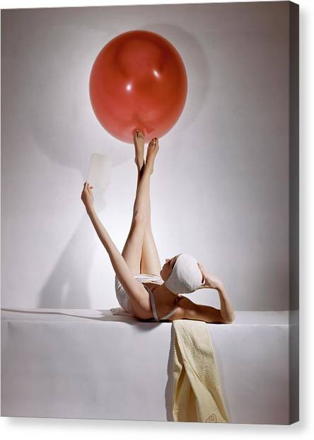 Fashion Canvas Print - A Model Balancing A Red Ball On Her Feet by Horst P Horst