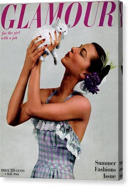 A Model Holding A Kitten Canvas Print by Gjon Mili