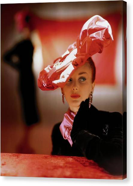 A Model In A Suzanne Et Roger Hat Canvas Print by John Rawlings