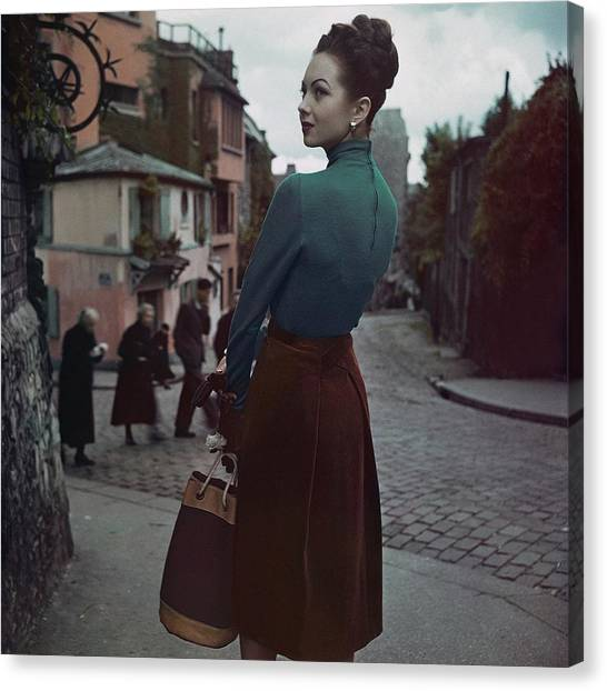 A Model In Paris Canvas Print by John Rawlings