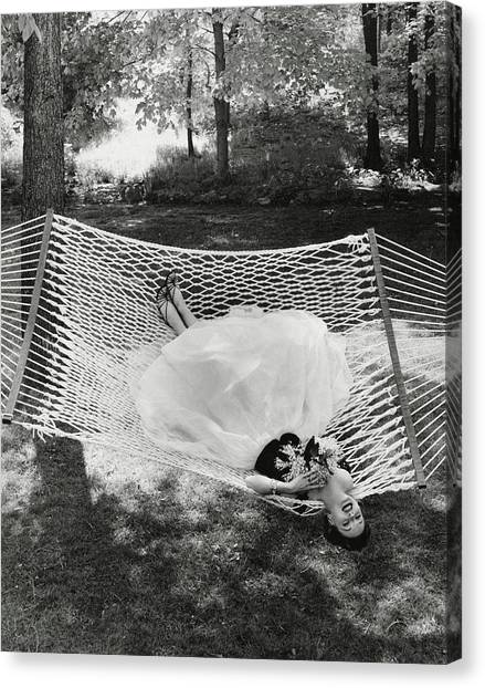 A Model Lying On A Hammock Canvas Print