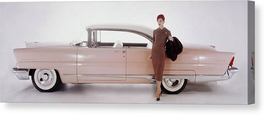 Adele Canvas Print - A Model Posing In Front Of A Vintage Car by Karen Radkai