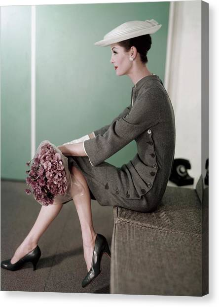 A Model Sitting Down With A Bouquet Of Flowers Canvas Print by Karen Radkai