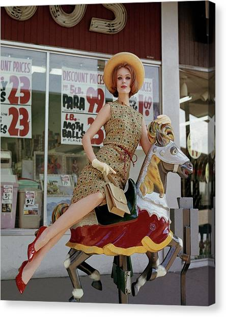 A Model Sitting On A Rocking Horse Canvas Print by George Barkentin
