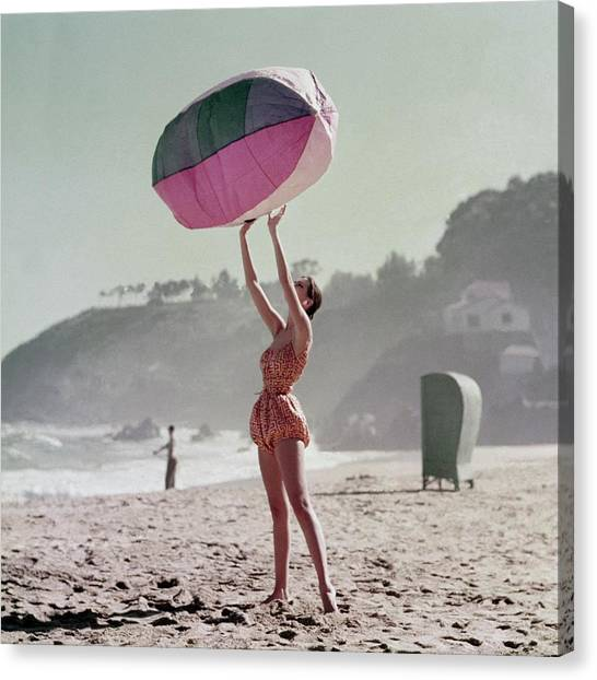 Inflatable Canvas Print - A Model Wearing A Bathing Suit Holding Up An by Richard Rutledge