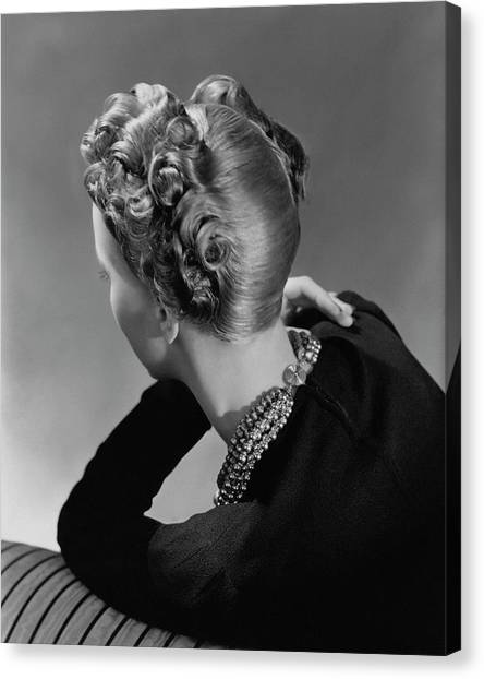 A Model Wearing A Curled Hairstyle Canvas Print by John Rawlings