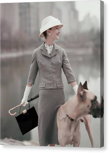 A Model Wearing A Gray Suit With A Dog Canvas Print