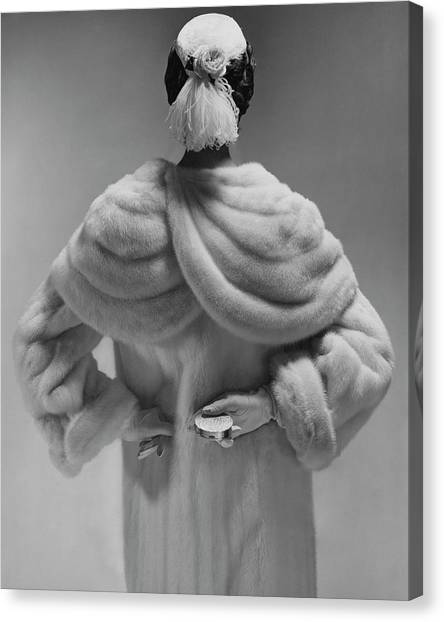 Ostriches Canvas Print - A Model Wearing A Mink Coat by Erwin Blumenfeld