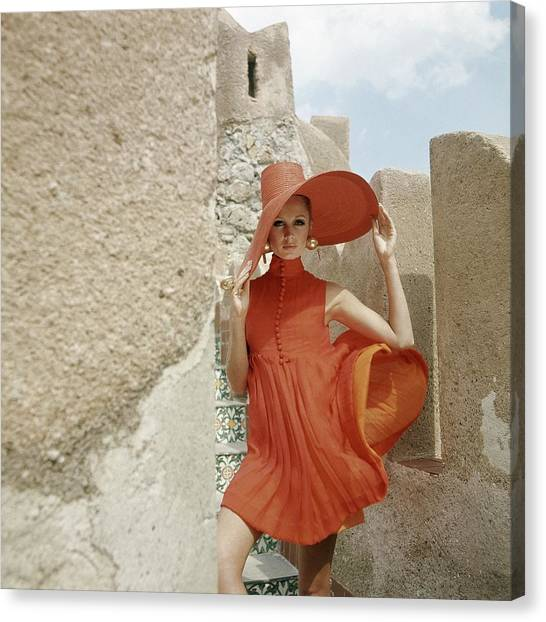 A Model Wearing A Orange Dress Canvas Print