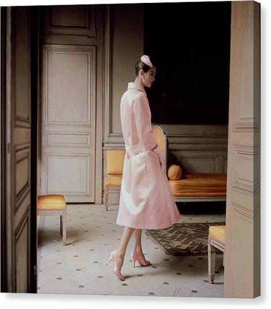 A Model Wearing A Pink Coat Canvas Print by Karen Radkai