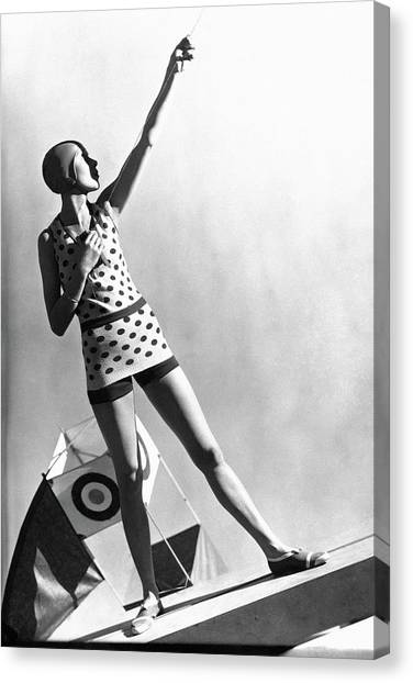 A Model Wearing A Polka Dot Swimsuit Canvas Print