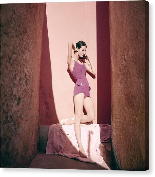 A Model Wearing A Purple Bathing Suit Canvas Print