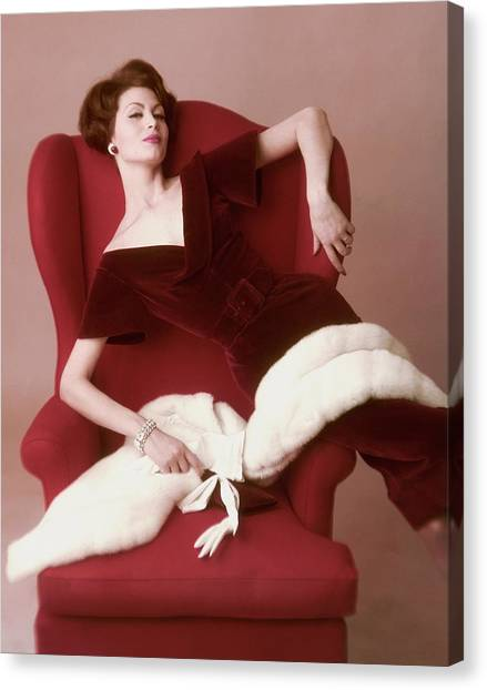 A Model Wearing A Red Velvet Dress Canvas Print by John Rawlings