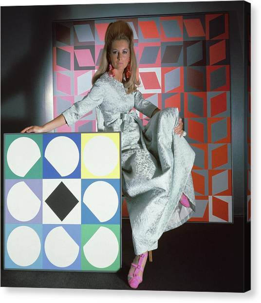 Suga Canvas Print - A Model Wearing A Stella Robe With Vasarely by Horst P. Horst