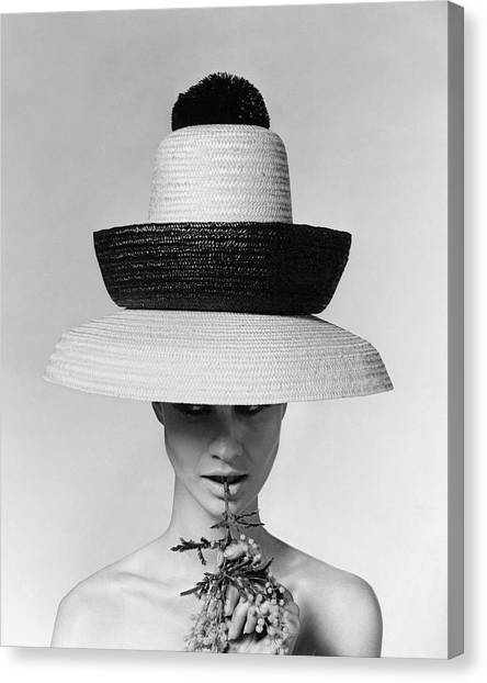 Shoulders Canvas Print - A Model Wearing A Sun Hat by Karen Radkai