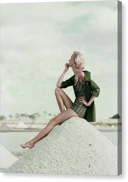 A Model Wearing A Swimsuit And Jacket Canvas Print