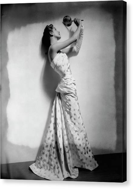A Model Wearing Leaf Patterned Dress Canvas Print by Cecil Beaton