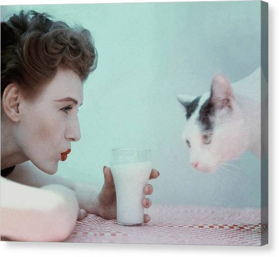 A Model With A Cat Canvas Print