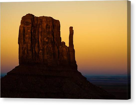 A Monument Of Stone - Monument Valley Tribal Park Canvas Print by Gregory Ballos