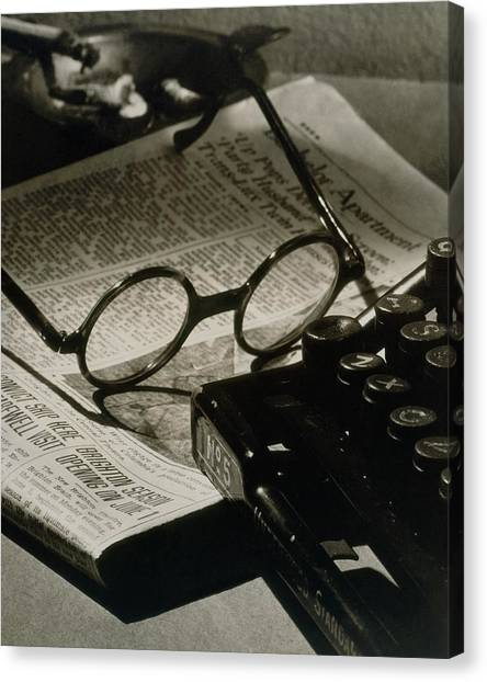 A Pair Of Glasses On Top Of A Newspaper Canvas Print