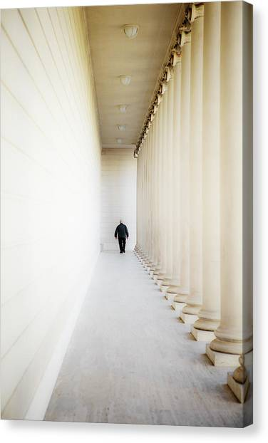 The Legion Canvas Print - A Person Among Columns by Ron Koeberer