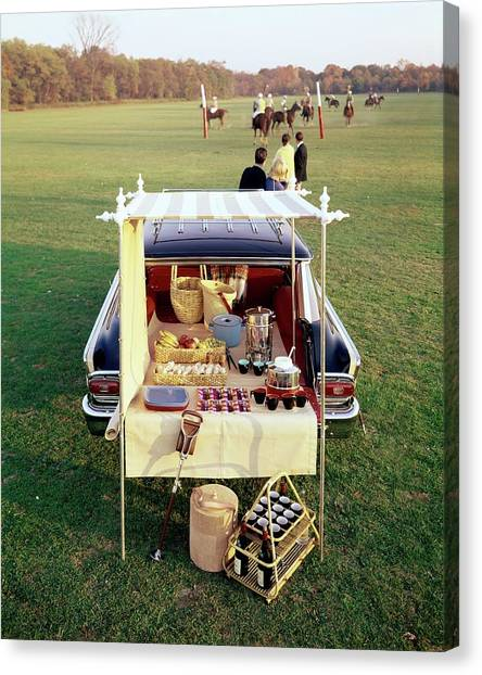 A Picnic Table Set Up On The Back Of A Car Canvas Print