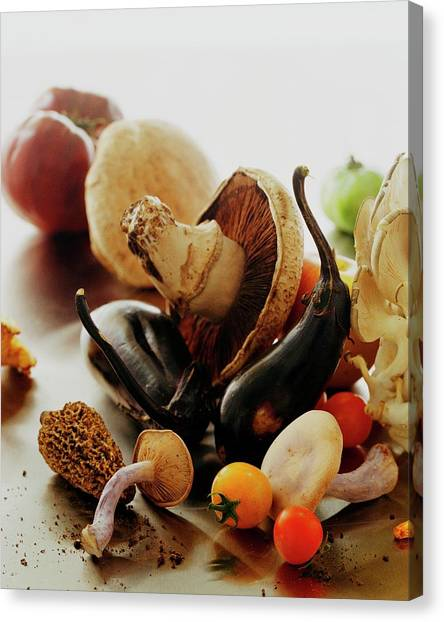 Eggplant Canvas Print - A Pile Of Vegetables by Romulo Yanes