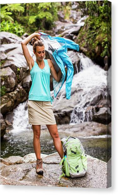 Tropical Rainforests Canvas Print - A Portrait Of A Woman Standing In Front by Michael Hanson